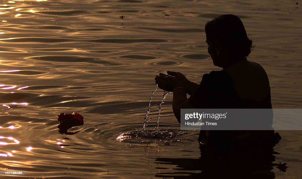 An Indian woman performing Ganga puja at Sangam, in the Kumbh Mela area, on February 19, 2013 in Allahabad, India. The next and second last official bathing of Maha Kumbh 2013 is set to take place on 'Maghi Purnima' on February 25.
