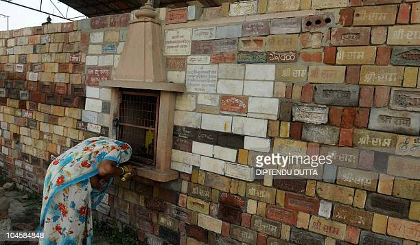 An Indian woman prays amidst stone bricks for the proposed Rama temple in Ayodhya on October 1 2010 An Indian court ruled September 30 that a...