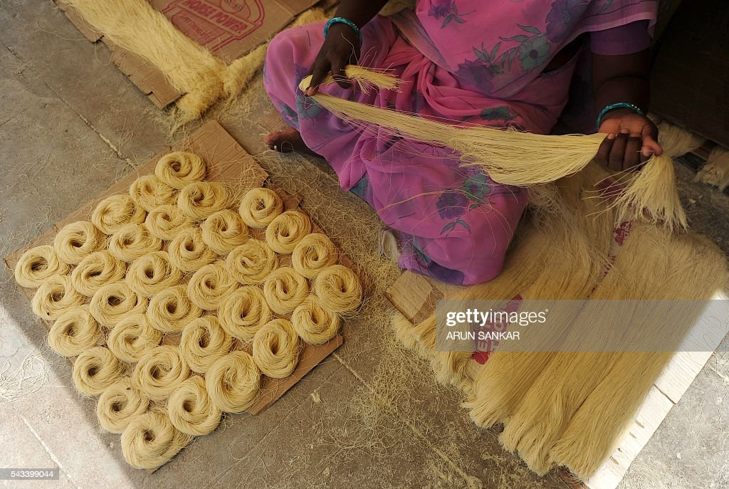 An Indian woman prepares seviiyan - thin vermicelli - which is used for the preparation of 'sheerkhorma', a traditional sweet dish prepared by muslims during the holy month of Ramadan, at a food factory in Chennai on June 28, 2016. Muslims around the world celebrate the month of Ramadan by abstaining from eating, drinking, and smoking as well as sexual activities from dawn to dusk. / AFP / ARUN