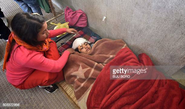 TOPSHOT An Indian woman receives medical attention following a 67 magnitude earthquake at a hospital in Imphal on January 4 2016 At least eight...