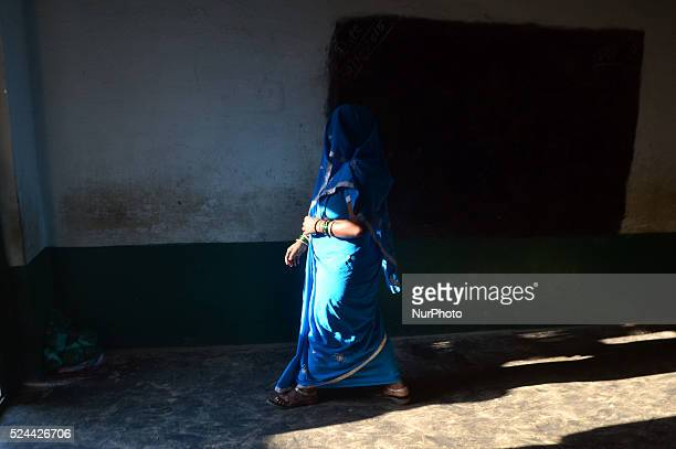 An indian woman returns after casring her vote for first phase of Panchayat elections at a polling centrein Rampur23 kms from Allahabad on October...