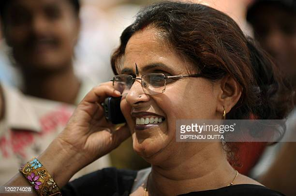 An Indian woman speaks on a cellullar telephone in Allahabad on April 10 2010 India's mobile phone firms have begun bidding to provide superfast...