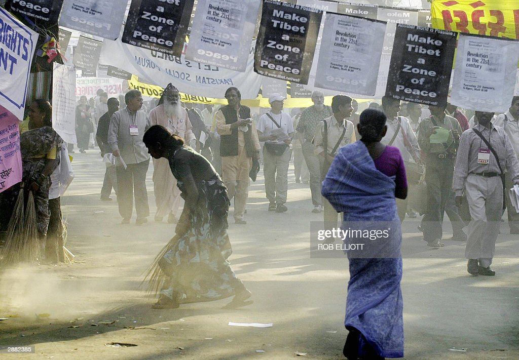 An Indian woman sweeps the grounds as delegates and activists arrrive for the fifth day at the 2004 World Social Forum in Bombay 20 January 2004 More...