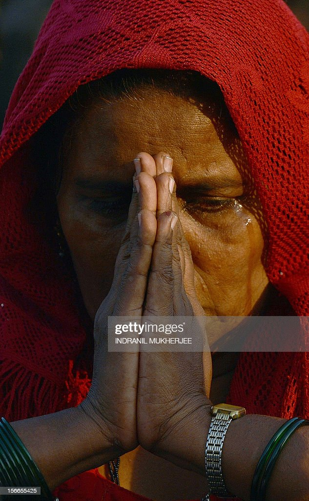 An Indian woman weeps during the funeral of Indian Hindu nationalist Shiv Sena party leader Bal Thackeray in Mumbai on November 18, 2012. Huge crowds gathered in Mumbai to witness the funeral procession of Bal Thackeray, chief of the Hindu nationalist Shiv Sena party and one of India's most divisive politicians. Thackeray, who called his followers 'Hindu warriors' and was widely accused of stoking ethnic and religious violence, died aged 86, triggering a virtual shutdown of the city.