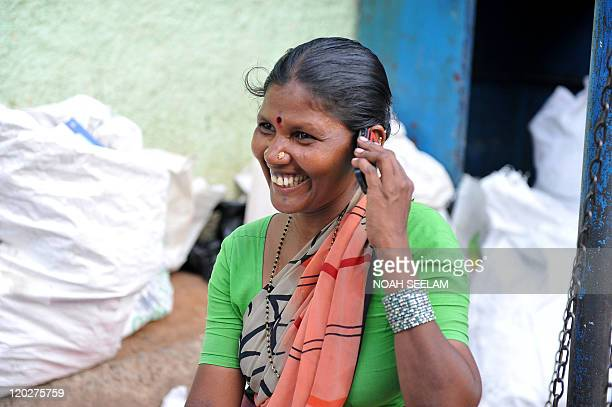 An Indian woman who collects plastic items speaks on a cellular telephone in Hyderabad on June 2 2011 With the World Health Organisation indicating...