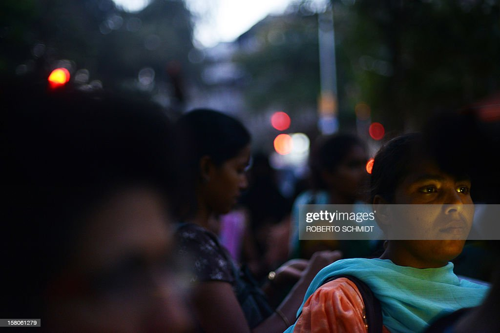 "An Indian woman's face is partially illuminated by a torch during a women's march in an effort to bring awareness to violence against her gender in Mumbai on December 10, 2012. A recent report by the New Delhi-based National Crimes Record Bureau (NCRB) found that a ""total of 228,650 incidents of crime against women were reported in the country during the year 2011 as compared to 213,585 incidents in the year 2010, recording an increase of 7.1 percent."" . People worldwide are celebrating Human Rights Day today. AFP PHOTO/Roberto Schmidt"