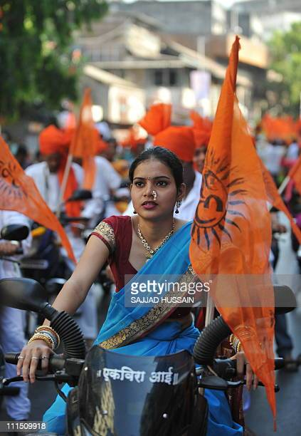 An Indian women dressed in traditional attire takes part in a procession during celebrations 'Gudi Padwa' or the Maharashtrian new year in Mumbai on...