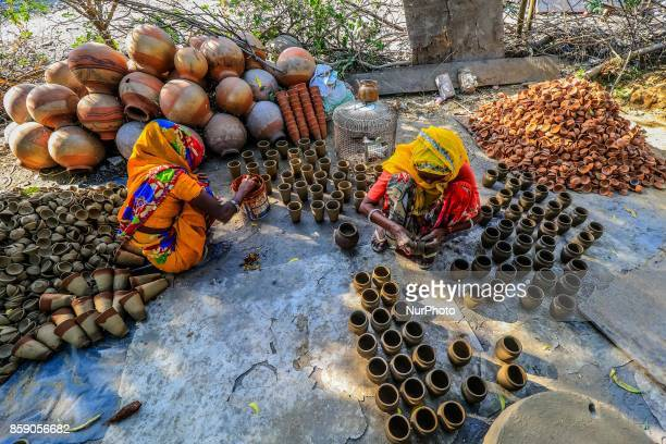 An Indian women potter makes earthen lamps and other items ahead of Diwali festival in JaipurRajasthan India 08 Oct2017 People buy earthen lamps to...