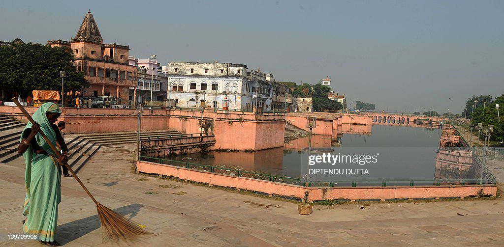 An Indian women sweeps at the 'Ram ki Pauri' in Ayodhya on October 2 2010 Schools shops and businesses reopened in Ayodhya Varanasi Lucknow and other...