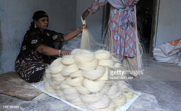 An Indian worker arranges dried Seviiyan thin vermicelli which is used for the preparation of sheerkhorma a traditional sweet dish prepared by the...