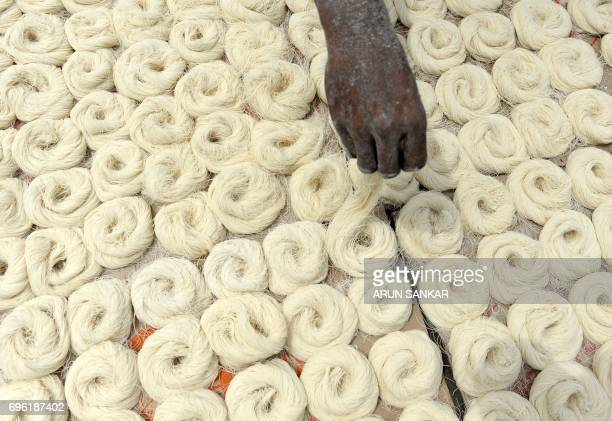 TOPSHOT An Indian worker dries thin vermicelli which is used to make sheerkhorma a traditional sweet dish prepared during the month of Ramadan in...