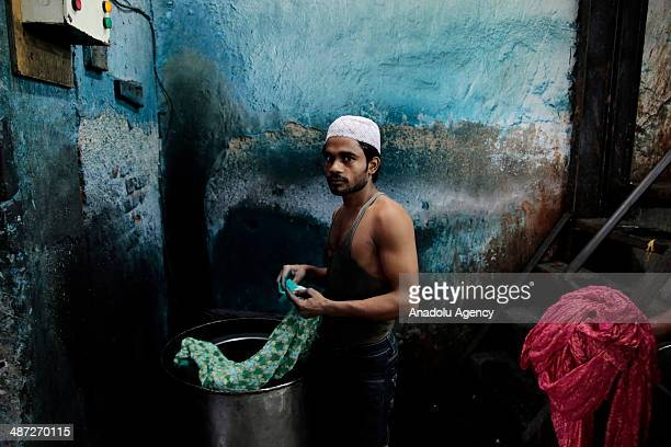 An Indian worker in Dharavi one of the largest slums in the world in capital city of the Indian state of Maharashtra Mumbai on April 25 2014 Dharavi...