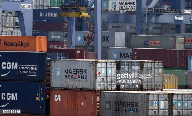 An Indian worker walks on stairs down a ladder of a crane at a container terminal in Chennai on March 20 2017 Indian Directorate of Revenue...