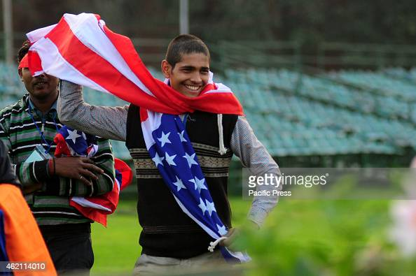 An Indian worker wraps the American flag before he puts them onto the poles ahead of the Indian Republic day in New Delhi India India's Prime...