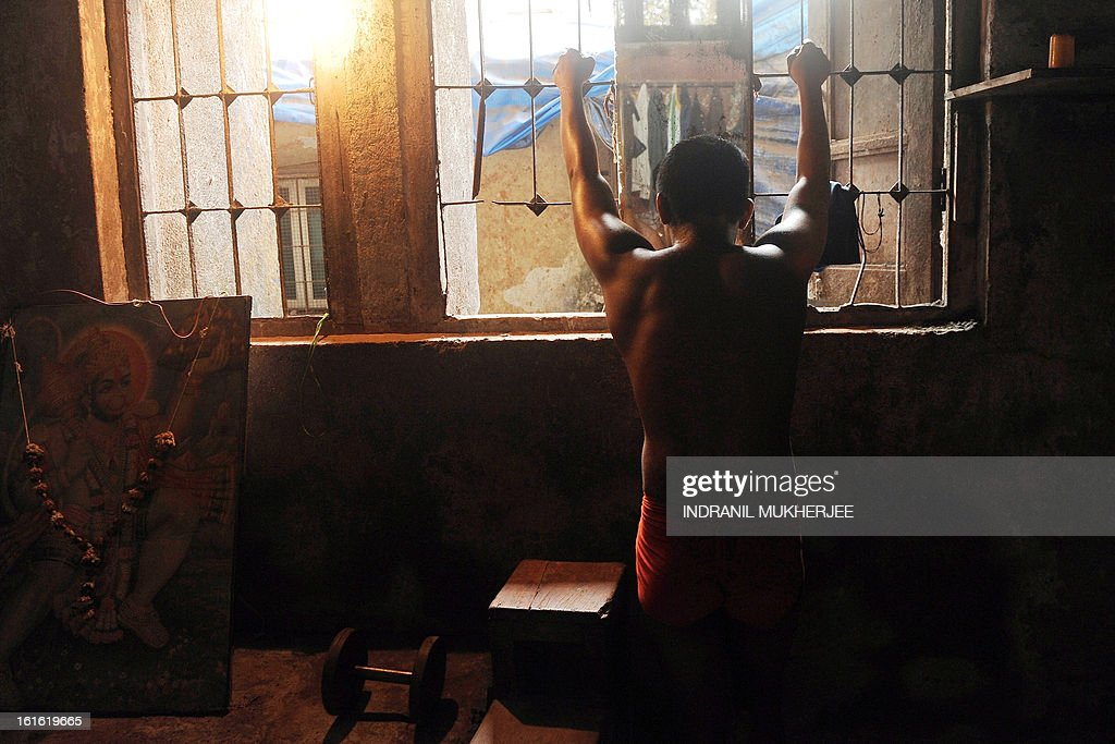 An Indian wrestler concentrates before an evening practice session at the Mahatma Phule Vyayam Mandir Kushti (traditional Indian wrestling) academy in Mumbai on February 13, 2013. Wrestlers around the world on Wednesday vowed to fight to save the ancient sport's Olympic status, after the International Olympic Committee voted to drop it for the 2020 Games. AFP PHOTO/Indranil MUKHERJEE