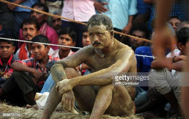 An Indian wrestler looks on after his victory during a traditional wrestling competition at a local fair in Rampur village near Allahabad on October...