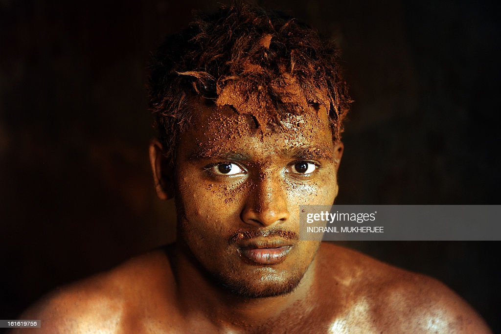 An Indian wrestler poses while resting after an evening practice session at the Mahatma Phule Vyayam Mandir Kushti (traditional Indian wrestling) academy in Mumbai on February 13, 2013. Wrestlers around the world on Wednesday vowed to fight to save the ancient sport's Olympic status, after the International Olympic Committee voted to drop it for the 2020 Games. AFP PHOTO/Indranil MUKHERJEE