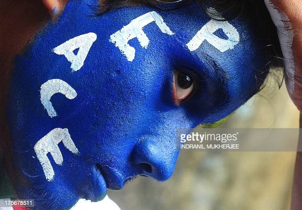 An Indian youth his face painted with a peace message takes part in a rally to mark Hiroshima Day in Mumbai on August 6 to mourn victims of the...