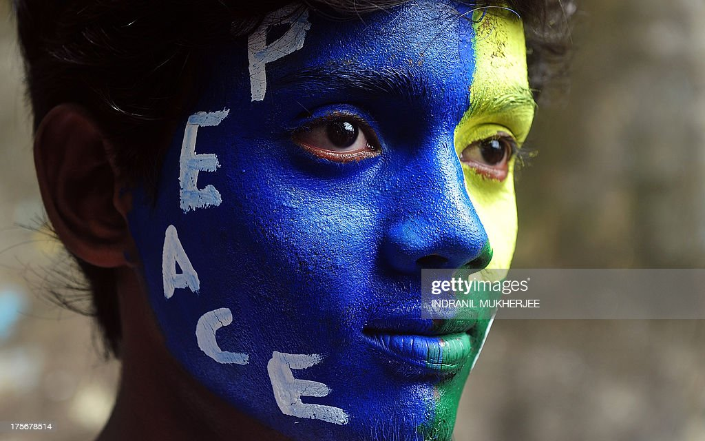An Indian youth, his face painted with a peace message, takes part in a rally to mark Hiroshima Day in Mumbai on August 6, 2013, to mourn victims of the atomic bombing of Hiroshima in 1945. Peace rallies and memorial services the world over marked the world's first nuclear attack on Hiroshima - the moment 68 years ago when a single US bomb instantly killed more than 140,000 people and fatally injured tens of thousands of others with radiation or horrific burns. AFP PHOTO/Indranil MUKHERJEE