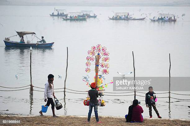 TOPSHOT An Indian youth sells handmade toys at Sangam during the Magh Mela festival in Allahabad on January 18 2017 The Magh Mela is held every year...