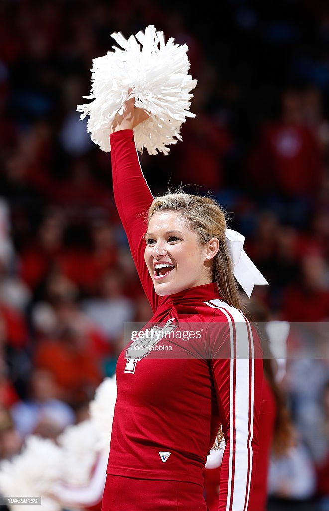 An Indiana Hoosiers cheerleader performs on the court in the second half against the Temple Owls during the third round of the 2013 NCAA Men's Basketball Tournament at UD Arena on March 24, 2013 in Dayton, Ohio.