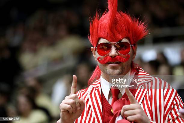 An Indiana Hoosiers fan cheers during the Big Ten conference rivalry game between the Indiana Hoosiers and the Purdue Boilermakers on February 28 at...