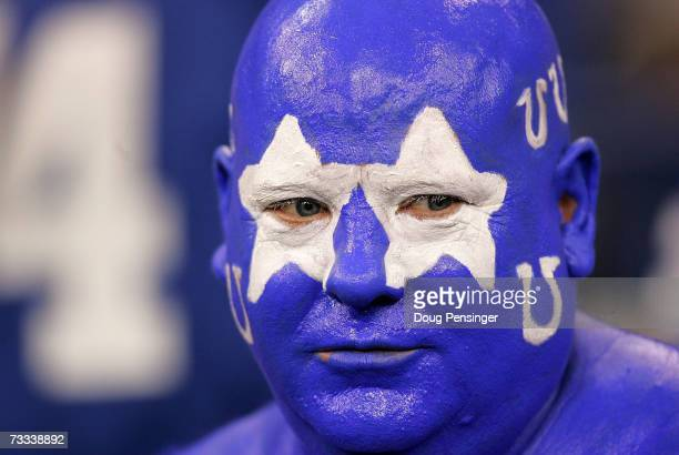 An Indianapolis Colts fan watches his team warm up prior to the start of the AFC Championship Game between the the New England Patriots and the...