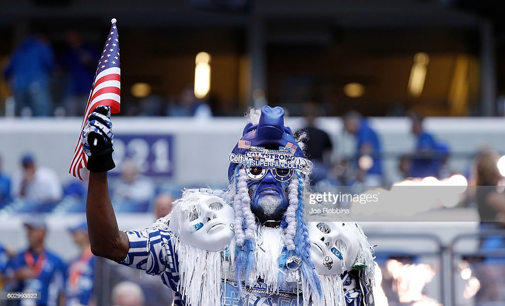 An Indianapolis Colts fan waves an American flag before the start of game between the Indianapolis Colts and the Detroit Lions at Lucas Oil Stadium on September 11, 2016 in Indianapolis, Indiana.