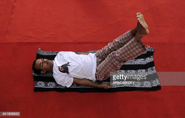 An Indians attendee takes part in a mass yoga session to mark International Yoga Day in Agartala on June 21 2016 / AFP / ARINDAM DEY