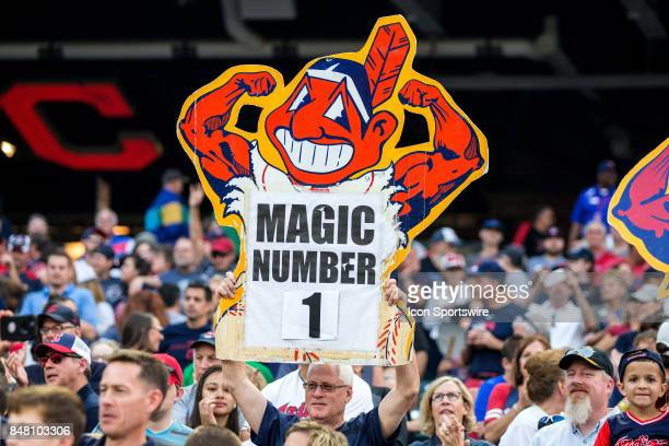 An Indians fan holds up a sign displaying the Cleveland Indians magic number of one following the Major League Baseball game between the Kansas City...