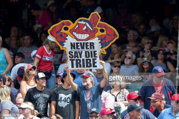 An Indians fan holds up a sign during the ninth inning of the Major League Baseball Interleague game between the Colorado Rockies and Cleveland...