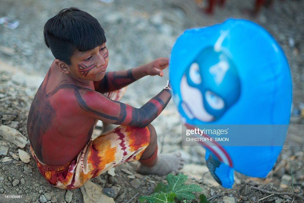 An indigenous boy waits for the start of the opening ceremony of the International Games of Indigenous Peoples, in Cuiaba, state of Mato Grosso, on November 9, 2013. 48 Brazilian ethnic groups and indigenous representatives from 16 countries are taking part in the event which runs until November 16.