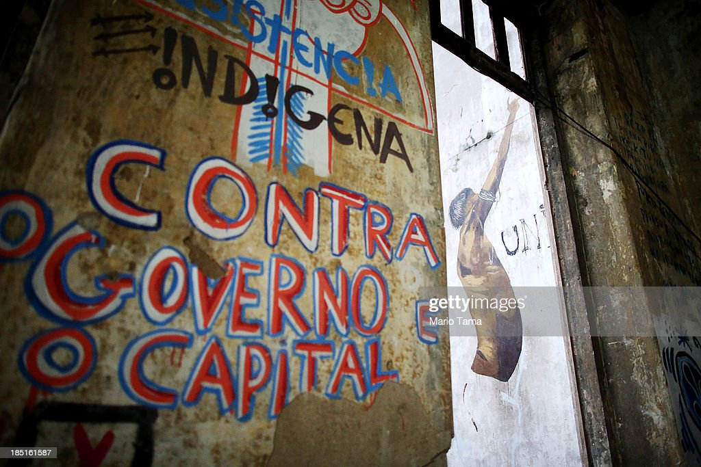 An indigenous community's writing and artwork cover walls in the Aldeia Maracana building they are occupying next to Maracana Stadium, the site of the 2014 World Cup finals, on October 17, 2013 in Rio de Janeiro, Brazil. The fading Aldeia Maracana used to house the Museum of Indian Culture before deteriorating and becoming occupied by squatting indigenous members in 2006. The building was slated for destruction ahead of the 2014 World Cup and the community was forcibly evicted in March. However, the community has managed to return and thus far have successfully battled to save the structure, which they hope to convert into an indigenous university. Indigenous groups throughout Brazil are battling the Brazilian government over land rights and other issues.