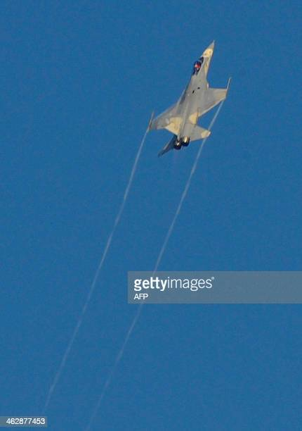 An Indigenous Defence Fighter flies during a combat skills demonstration at a military base in Tainan southern Taiwan on January 16 2014 Taiwan on...