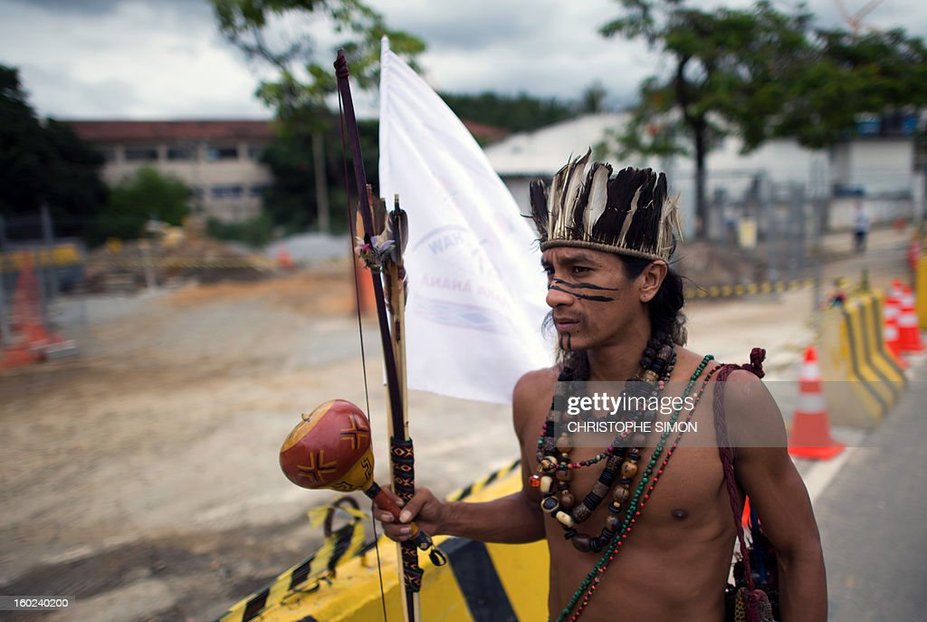 An indigenous delegation --representing those living at the former Indigenous Museum, aka Aldea Maracana, next to the Maracana stadium-- head for a meeting with official representatives in Rio de Janeiro on January 28, 2013. Rio's governor Sergio Cabral gave up the demolition project to construct 10,500 parking lots for the upcoming Brazil 2014 FIFA World Cup, following a series of lawsuit against it, and announced a refurbishment plan. Indigenous people have been occupying the place since 2006.