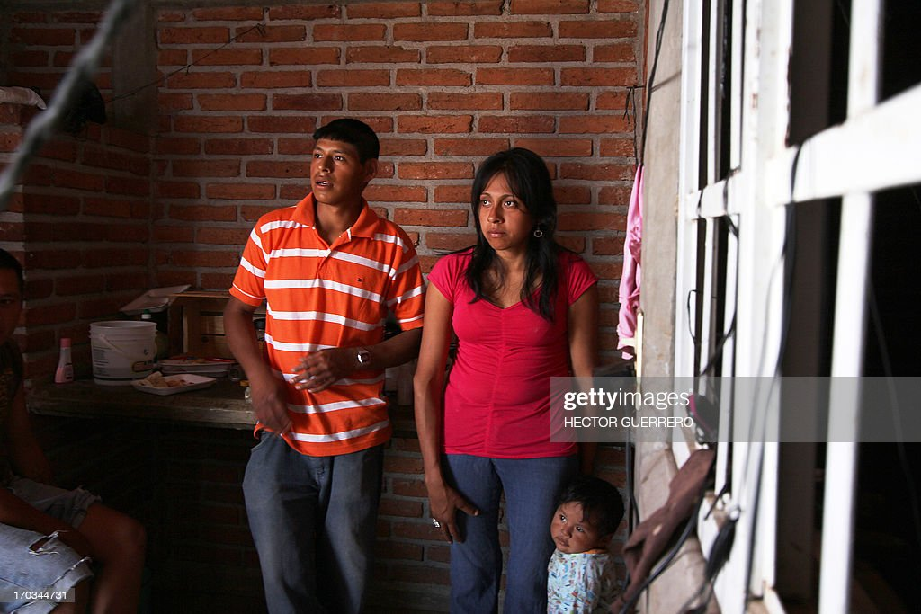 An indigenous family from Veracruz state are seen at a tomato processing plant in Toliman, Jalisco state, Mexico on June 11, 2013. Some 270 workers were freed, after they were found living in poor conditions and deprived of their freedom. AFP PHOTO/Hector Guerrero
