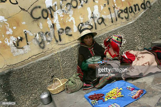 An indigenous Indian woman one of thousands sells items on the street December 19 2005 in downtown La Paz Bolivia A day after the historic election...