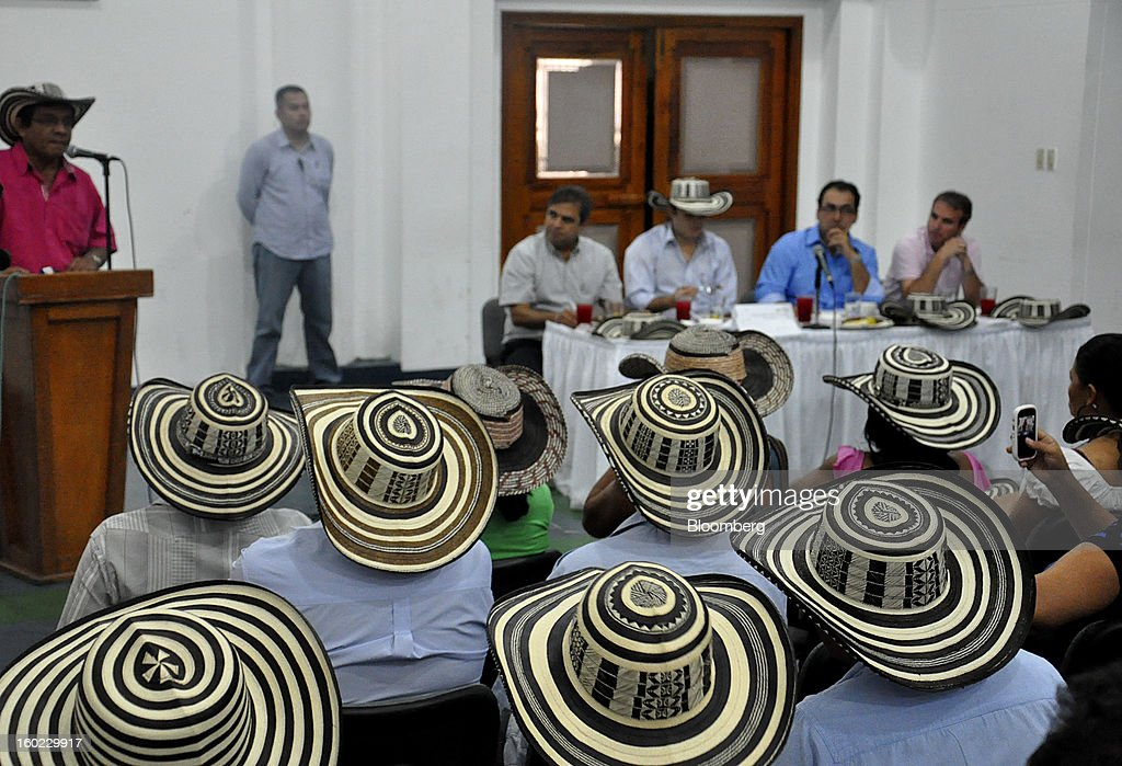 An indigenous leader, left, speaks during a meeting with government officials and local manufacturers of woven hats, known as sombreros vueltiaos, in Monteria, Colombia, on Saturday, Jan. 19, 2013. Chinese-made imitations of the hats sell for half the $20 price of the least expensive originals. In response to plunging sales by artisans who spend up to 15 days cutting, sun-drying and braiding cane leaves to make a single hat, the government is rushing to protect one of the nation's symbols and ban plastic, machine-made rip-offs. Photographer: Joshua Goodman/Bloomberg via Getty Images
