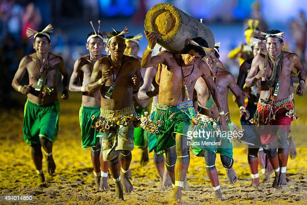 An indigenous man carries a painted log during the opening ceremony of the first World Games for Indigenous Peoples in Palmas on October 23 2015 in...