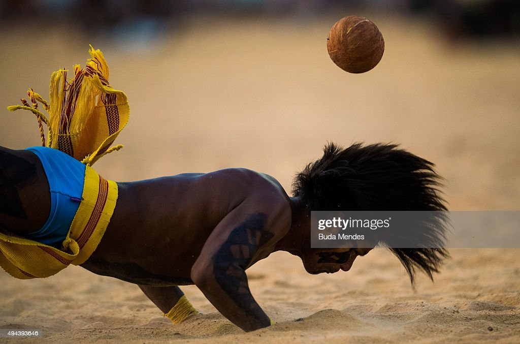An indigenous man from the Paresi tribe tries to head the ball during the Jikunahati competition a form of soccer played with one's head during at...