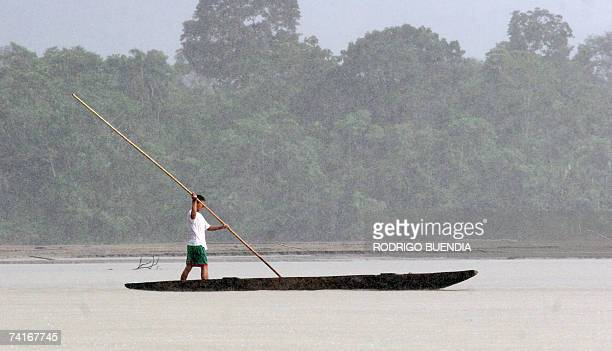 An indigenous man navagates along the Napo River as it runs through the Yasuni National Park in the Ecuadorean Amazon region 300 km east of Quito on...