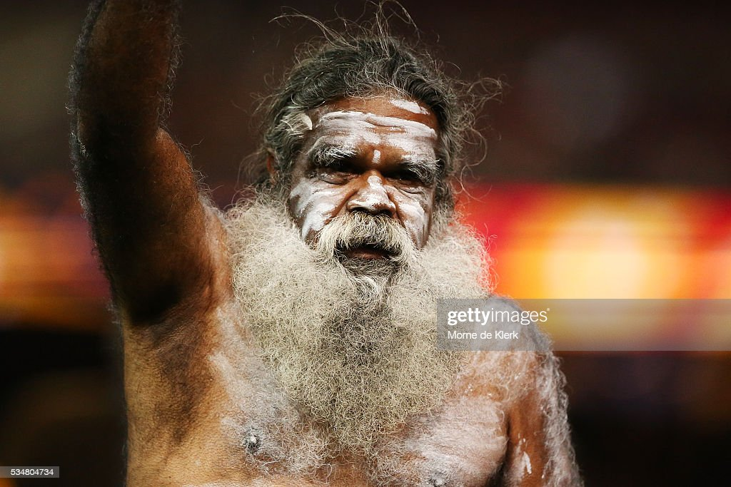An indigenous performer, performs before the start during the round 10 AFL match between the Adelaide Crows and the Greater Western Sydney Giants at Adelaide Oval on May 28, 2016 in Adelaide, Australia.