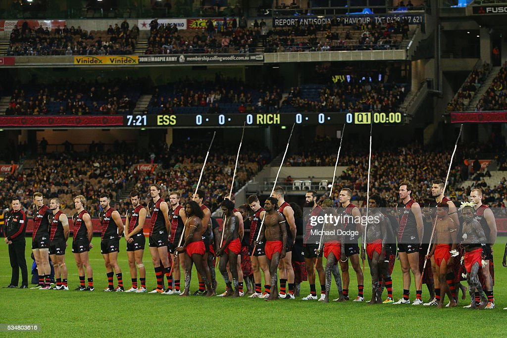 An Indigenous pre match war cry ceremony takes place in front of Bombers players during the round 10 AFL match between the Essendon Bombers and the Richmond Tigers at Melbourne Cricket Ground on May 28, 2016 in Melbourne, Australia.