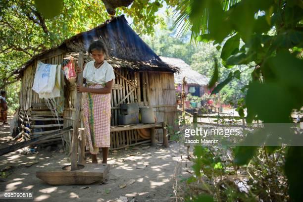 An indigenous Tagbanua woman pounding rice