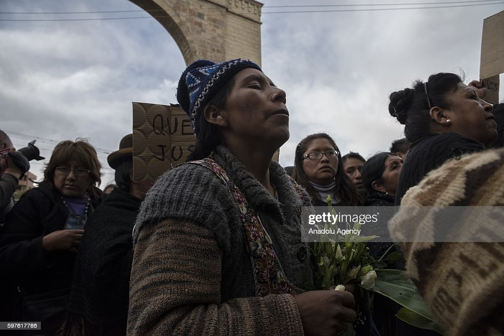 An indigenous woman at the cemetery gates during the burial of Deputy Minister Rodolfo Illanes in La Paz Bolivia on August 28 2016 Deputy Minister of...
