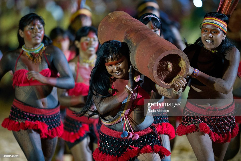 An indigenous woman carries a painted log during the opening ceremony of the first World Games for Indigenous Peoples in Palmas on October 23 2015 in...