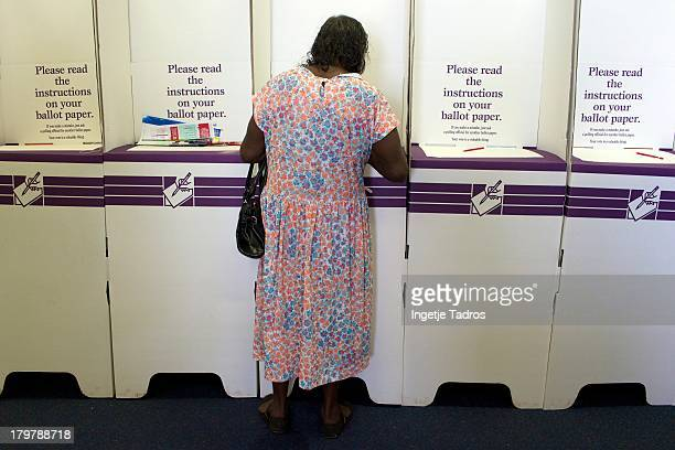An indigenous woman casts her vote at Broome Primary School on September 7 2013 in Broome Australia Australians today vote in the Federal Election in...
