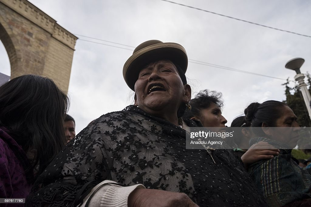 An indigenous woman cries at the cemetery gates during the burial of Deputy Minister Rodolfo Illanes in La Paz Bolivia on August 28 2016 Deputy...