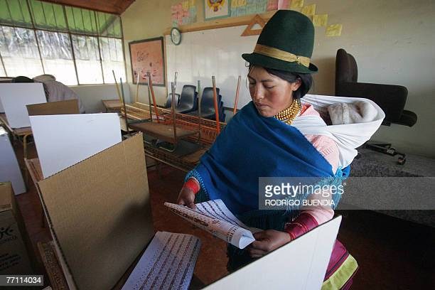 An indigenous woman prepares to vote 30 September 2007 in Cangahua Pichincha during the Constituent Assembly election About 93 millions Ecuadoreans...