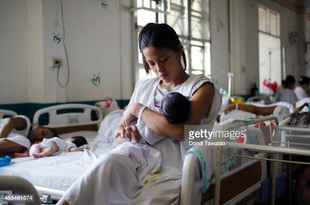 An indigent mother takes care of her new born infant at a government run hospital ward on August 11 2014 in Manila Philippines The Philippines has...